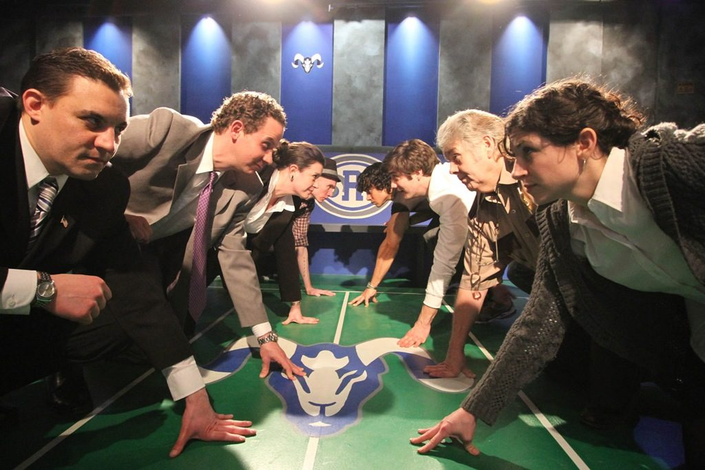 people in suits crouching like opposing football teams